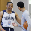 Oklahoma City Thunder guard Russell Westbrook (0) talks with teammate Jeremy Lamb following the NBA basketball team's practice in Oklahoma City, Friday, April 18, 2014. Oklahoma City will face the Memphis Grizzlies in the first round of the NBA playoffs T