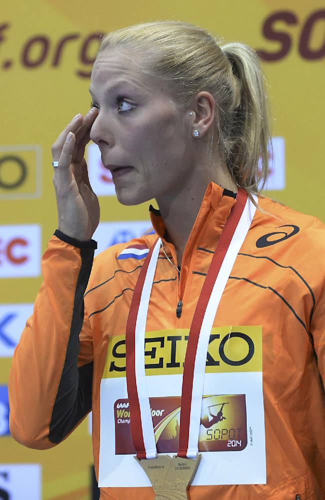 Netherlands' Nadine Broersen cries after she was awarded the gold medal after the women's pentathlon during the Athletics Indoor World Championships in Sopot, Poland, Friday, March 7, 2014