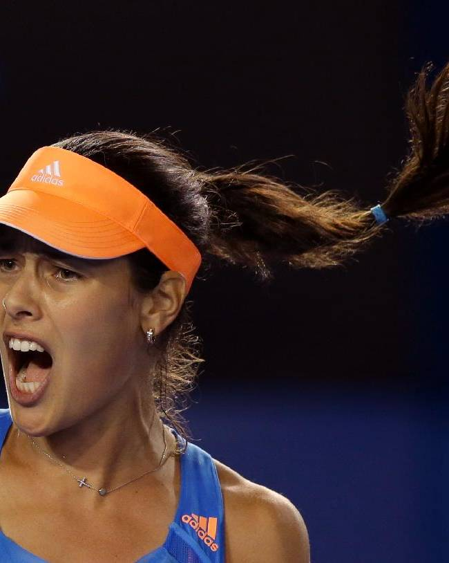 Ana Ivanovic of Serbia celebrates as she won the second set against  Samantha Stosur of Australia during their third round match at the Australian Open tennis championship in Melbourne, Australia, Friday, Jan. 17, 2014