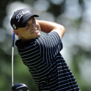 Bill Haas watches his drive from the fourth tee during the third round of the AT&T National golf tournament at Congressional Country Club, Saturday, June 29, 2013, in Bethesda, Md. (AP Photo/Nick Wass)