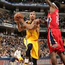 INDIANAPOLIS, IN - DECEMBER 23: George Hill #3 of the Indiana Pacers drives against the New Orleans Pelicans on December 23, 2014 at Bankers Life Fieldhouse in Indianapolis, Indiana. (Photo by Ron Hoskins/NBAE via Getty Images)