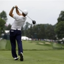 Jordan Spieth watches his drive from the 15th tee during the second round of the AT&T National golf tournament at Congressional Country Club, Friday, June 28, 2013, in Bethesda, Md. (AP Photo/Patrick Semansky)