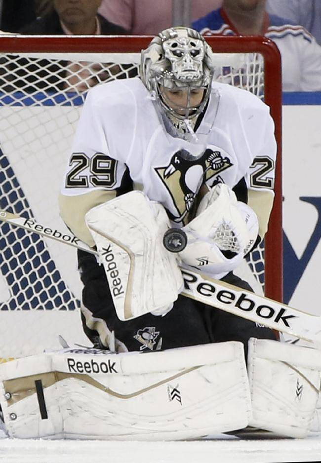 Pittsburgh Penguins goalie Marc-Andre Fleury (29) makes a save in the first period of their second-round NHL Stanley Cup hockey playoff game at Madison Square Garden in New York, Monday, May 5, 2014