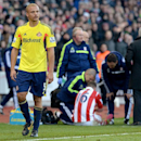 Sunderland s Wes Brown leaves the pitch after being shown a red card for a challenge on Stoke City s Charlie Adam during their English Premier League soccer match at Stoke, England, Saturday, Nov 23, 2013. (AP Photo / Martin Rickett, PA)