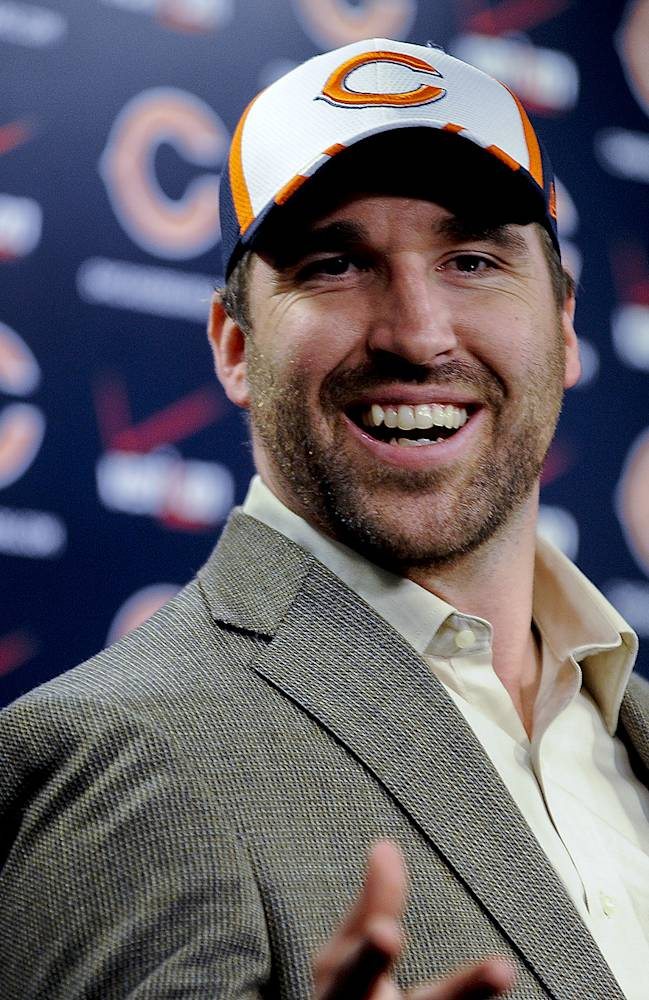 New Chicago Bears NFL football player Jared Allen, laughs while he talked to the media at a news conference where Allen was introduced Monday, March 31, 2014, in Lake Forest, Ill