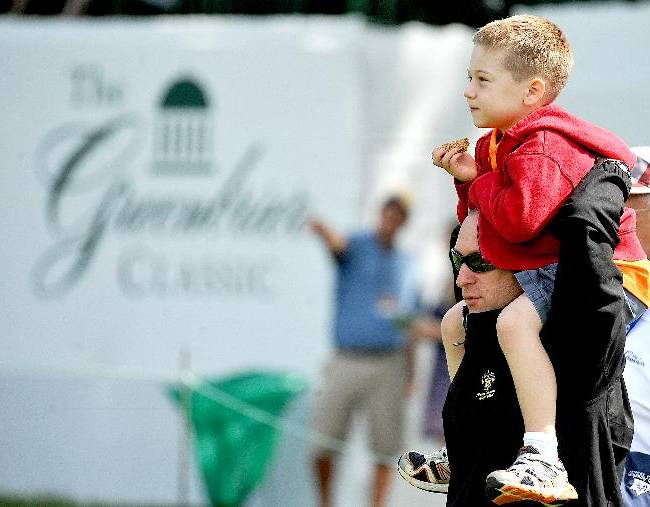 Jeff Vogel holds his six-year-old son, James, on his shoulders near the 17th green during the second round of the Greenbrier Classic golf tournament at the Greenbrier Resort in White Sulphur Springs, W.Va., Friday, July 4, 2014