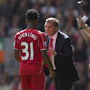 Liverpool's manager Brendan Rodgers, right, issues instructions to Raheem Sterling during their English Premier League soccer match against Southampton at Anfield Stadium, Liverpool, England, Sunday Aug. 17, 2014