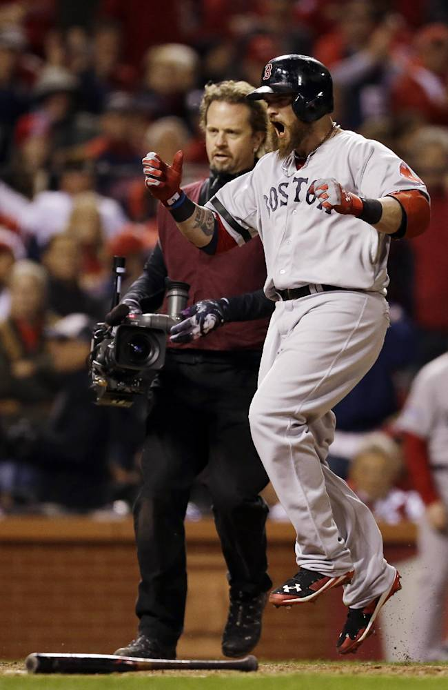 Boston Red Sox's Jonny Gomes celebrates at home after hitting a three-run home run during the sixth inning of Game 4 of baseball's World Series against the St. Louis Cardinals Sunday, Oct. 27, 2013, in St. Louis