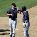 Cleveland Indians' Ryan Raburn, left, is congratulated on his two-run home run that scored Elliot Johnson, right, off a pitch from Seattle Mariners relief pitcher Lucas Luetge in the seventh inning of a spring training baseball game, Wednesday, March 5, 2