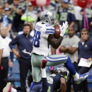 Dallas Cowboys wide receiver Dez Bryant, top, is tackled by Seattle Seahawks cornerback Richard Sherman in the first half of an NFL football game, Sunday, Oct. 12, 2014, in Seattle. Sherman was penalized for tripping on the play The Associated Press
