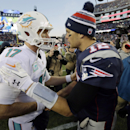 Miami Dolphins quarterback Ryan Tannehill, left, congratulates New England Patriots quarterback Tom Brady, right, after the Patriots beat the Dolphins 41-13 in an NFL football game Sunday, Dec. 14, 2014, in Foxborough, Mass The Associated Press