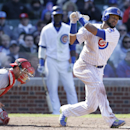 Chicago Cubs' Emilio Bonifacio, right, strikes out swinging during the seventh inning of a baseball game against the Cincinnati Reds in Chicago, Friday, April 18, 2014. The Reds won 4-1 The Associated Press