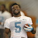 Miami Dolphins running back Damien Williams (5) laughs during NFL football training camp in Davie, Fla., Wednesday, July 30, 2014 The Associated Press