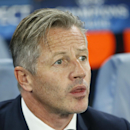 Schalke's head coach Jens Keller waits for the beginning of the Champions League group G soccer match between Chelsea and Schalke 04 at Stamford Bridge stadium in London, Wednesday, Sept. 17, 2014