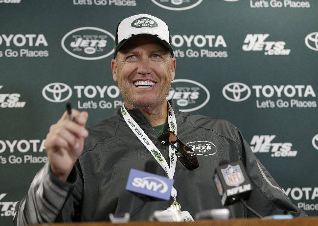 New York Jets head coach Rex Ryan smiles during a news interview during NFL football training camp Thursday, July 24, 2014, in Cortland, N.Y.  (AP Photo)