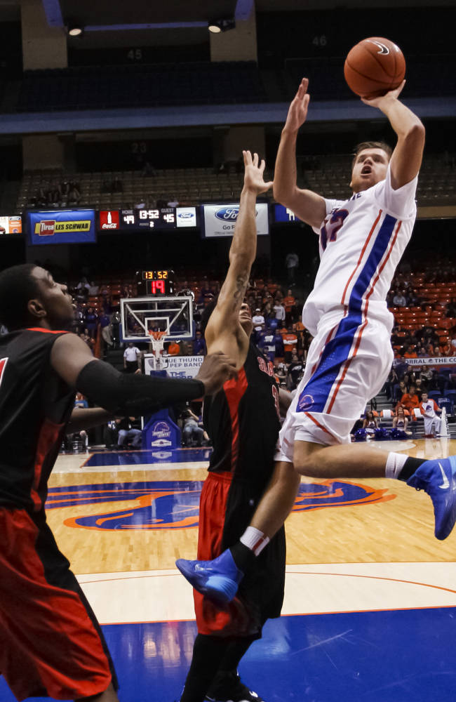 Boise State's Igor Hadziomerovic shoots over Seattle's William Powell (21) and Jarell Flora (center) during the second half of an NCAA college basketball game in Boise, Idaho, Tuesday, Nov. 19, 2013. Boise State beat Seattle 86-68
