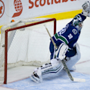 Vancouver Canucks goalie Ryan Miller allows a second goal to Arizona Coyotes Martin Hanzal, of the Czech Republic, during the second period of an NHL hockey game in Vancouver, British Columbia, on Friday Nov. 14, 2014 The Associated Press