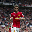 Manchester United's Juan Mata celebrates after scoring against Queens Park Rangers during their English Premier League soccer match at Old Trafford Stadium, Manchester, England, Sunday Sept. 14, 2014