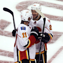 Calgary Flames center Mikael Backlund, left, celebrates with right wing Devin Setoguchi after the Flames defeated the Chicago Blackhawks 2-1 in overtime in an NHL hockey game in Chicago, Wednesday, Oct. 15, 2014 The Associated Press