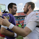 Baltimore Ravens quarterback Joe Flacco, left, meets Miami Dolphins quarterback Ryan Tannehill, right, after an NFL football game, Sunday, Dec. 7, 2014, in Miami Gardens, Fla. The Ravens defeated the Dolphins 28-13 The Associated Press