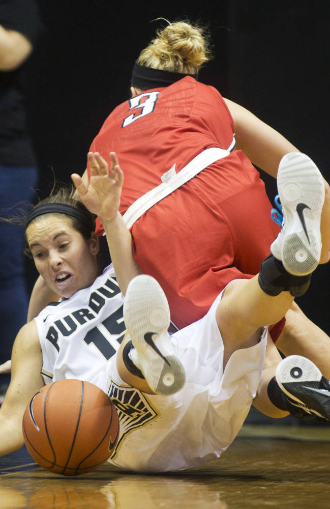 Purdue University's Courtney Moses, left, and Ball State's Shelbie Justice go down battling for the ball during an NCAA college basketball game Sunday, Nov. 10, 2013, in West Lafayette, Ind. Purdue defeated Ball State 63-57