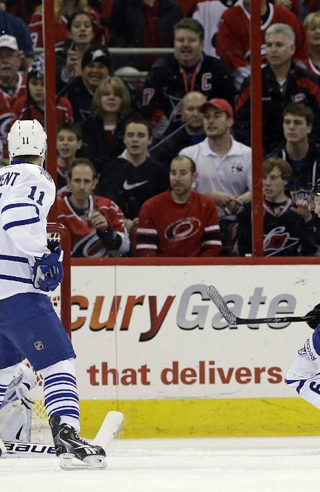 Carolina Hurricanes' Jeff Skinner (53) scores on Toronto Maple Leafs goalie James Reimer as Maple Leafs' Jay McClement (11) and Jerry D'Amigo (29) defend during the first period of an NHL hockey game in Raleigh, N.C., Thursday, Jan. 9, 2014