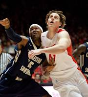 New Mexico's Cameron Bairstow, right, battles Charleston Southern's Paul Gombwer for a rebound in the first half of an NCAA basketball game, Sunday, Nov. 17, 2013 in Albuquerque, N.M. (AP Photo/Eric Draper)