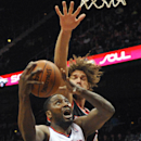 Atlanta Hawks' Elton Brand (42) shoots in front of Portland Trail Blazers' Robin Lopez, right, in the first half of their NBA basketball game Thursday, March 27, 2014, in Atlanta The Associated Press