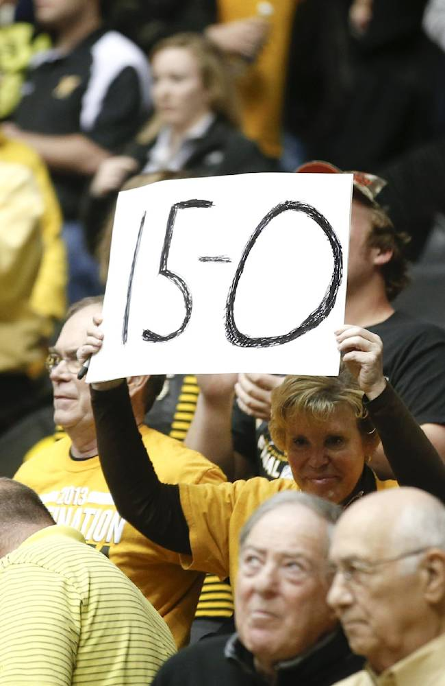 A Wichita State fan holds a 15-0 sign in the final seconds against Northern Iowa during the second half of an NCAA college basketball game in Wichita, Kan., Sunday, Jan. 5, 2014