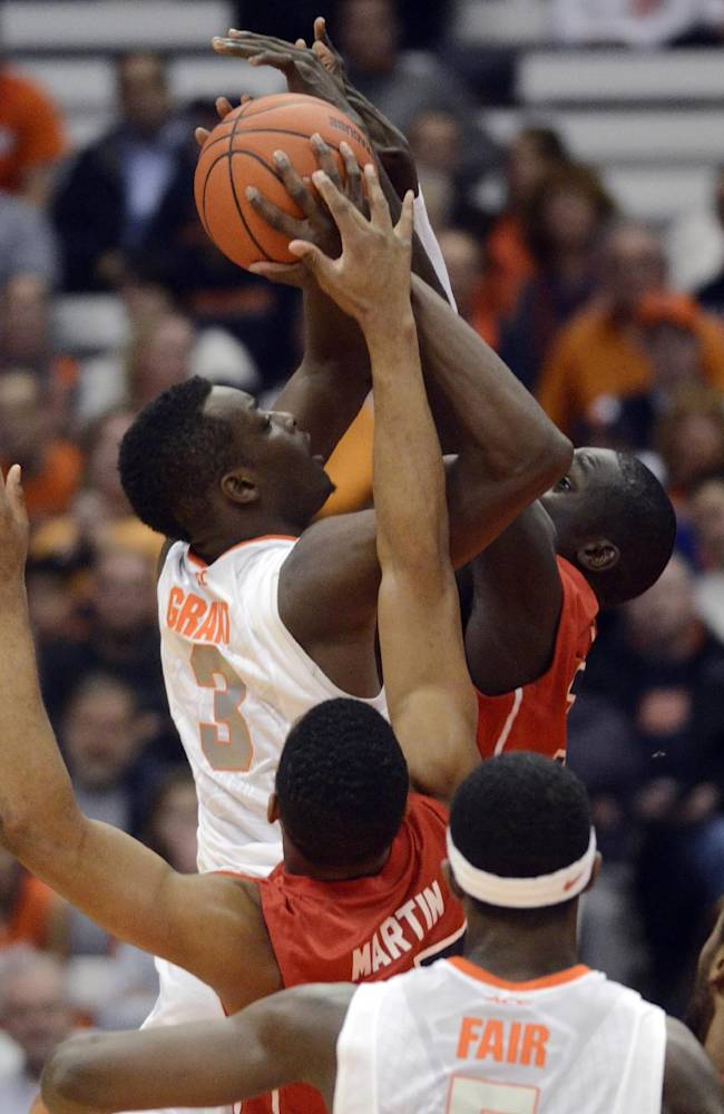 Syracuse's Jerami Grant (3) drives to the basket against St. Francis' Andy Fall during the first half of an NCAA college basketball game in Syracuse, N.Y., Monday, Nov. 18, 2013