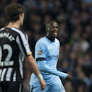 Manchester City's Yaya Toure grimaces as he walks from the pitch after being substituted as his team are beaten 2-0 by Newcastle during the English League Cup soccer match between Manchester City and Newcastle at the Etihad Stadium, Manchester, England, W