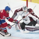 Colorado Avalanche goaltender Calvin Pickard makes a save against Montreal Canadiens' Alex Galchenyuk during the second period of an NHL hockey game, Saturday, Oct. 18, 2014 in Montreal The Associated Press