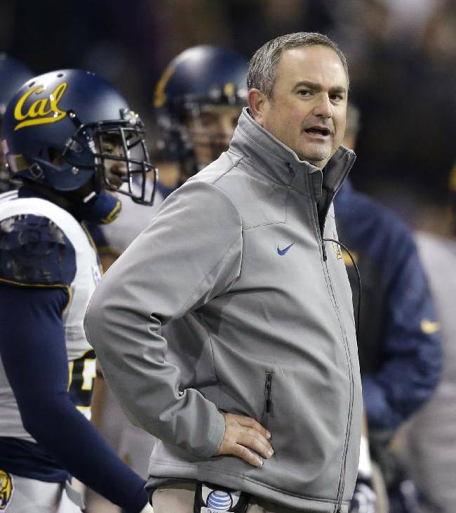 California head coach Sonny Dykes looks on against Washington in the first half of an NCAA college football game Saturday, Oct. 26, 2013, in Seattle