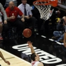 Ohio State's Aaron Craft puts up an off balance shot during the second half of an NCAA college basketball game against Michigan State at the Big Ten tournament Saturday, March 16, 2013, in Chicago. Ohio State won 61-58. (AP Photo/Charles Rex Arbogast)