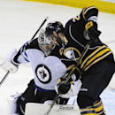 Winnipeg Jets goaltender Ondrej Pavelec (31), of the Czech Republic, makes a save on Buffalo Sabres right winger Drew Stafford (21), during the third period of an NHL hockey game Wednesday, Nov. 26, 2014, in Buffalo, N.Y. Winnipeg won 2-1 The Associated P