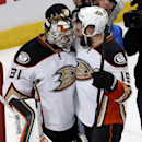 Anaheim Ducks goalie Frederik Andersen, left, and left wing Patrick Maroon celebrate after Game 3 of the Western Conference finals against the Chicago Blackhawks in the NHL hockey Stanley Cup playoffs, Thursday, May 21, 2015, in Chicago. The Ducks won 2-1. (AP Photo/Charles Rex Arbogast)