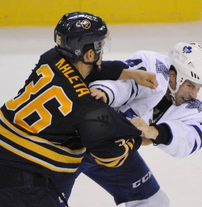 Buffalo Sabres' Patrick Kaleta (36) throws a punch at Toronto Maple Leafs' Troy Bodie (40) during the third period of an NHL hockey preseason game in Buffalo, N.Y., Saturday, Sept. 21, 2013