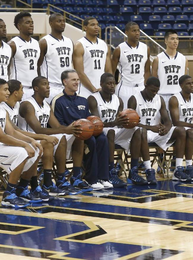 The Pittsburgh team gathers around coach Jamie Dixon for a team photograph during the NCAA college basketball team's annual media day, Thursday, Sept. 26, 2013, in Pittsburgh. Pittsburgh is moving from the Big East to the Atlantic Coast Conference this season