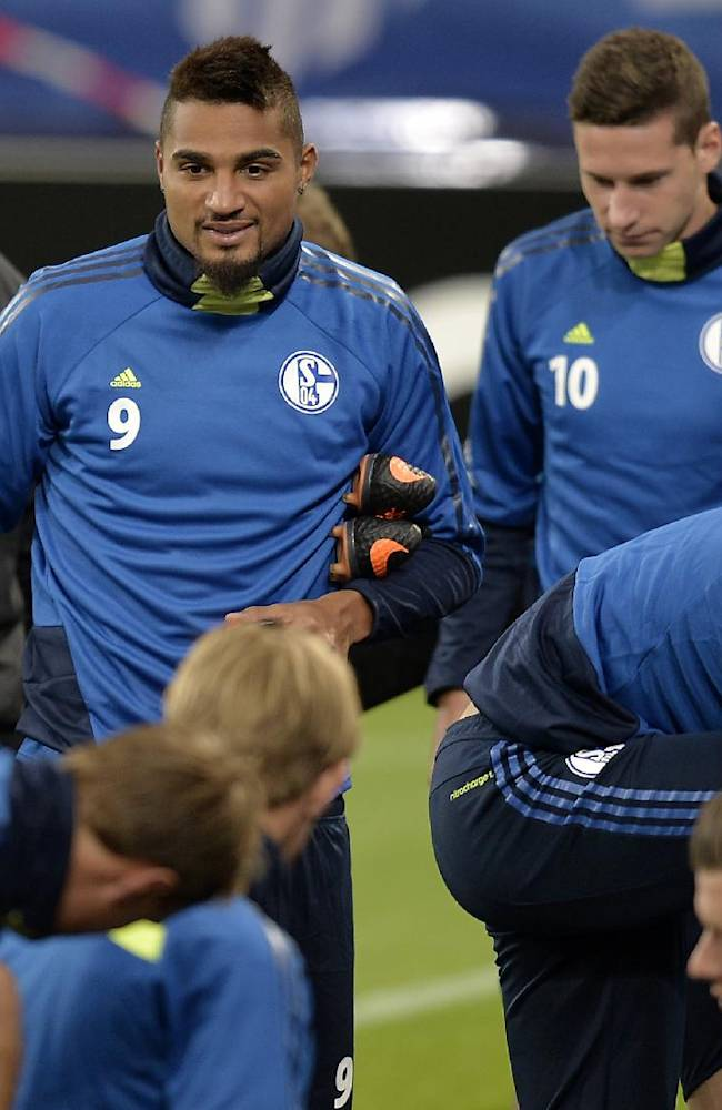 Schalke's Kevin-Prince Boateng of Ghana, and Schalke's Julian Draxler, from left, arrive at the last training session prior the Champions League Group E soccer match between FC Schalke 04 and Steaua Bucuresti in Gelsenkirchen, Germany, Tuesday, Sept. 17, 2013
