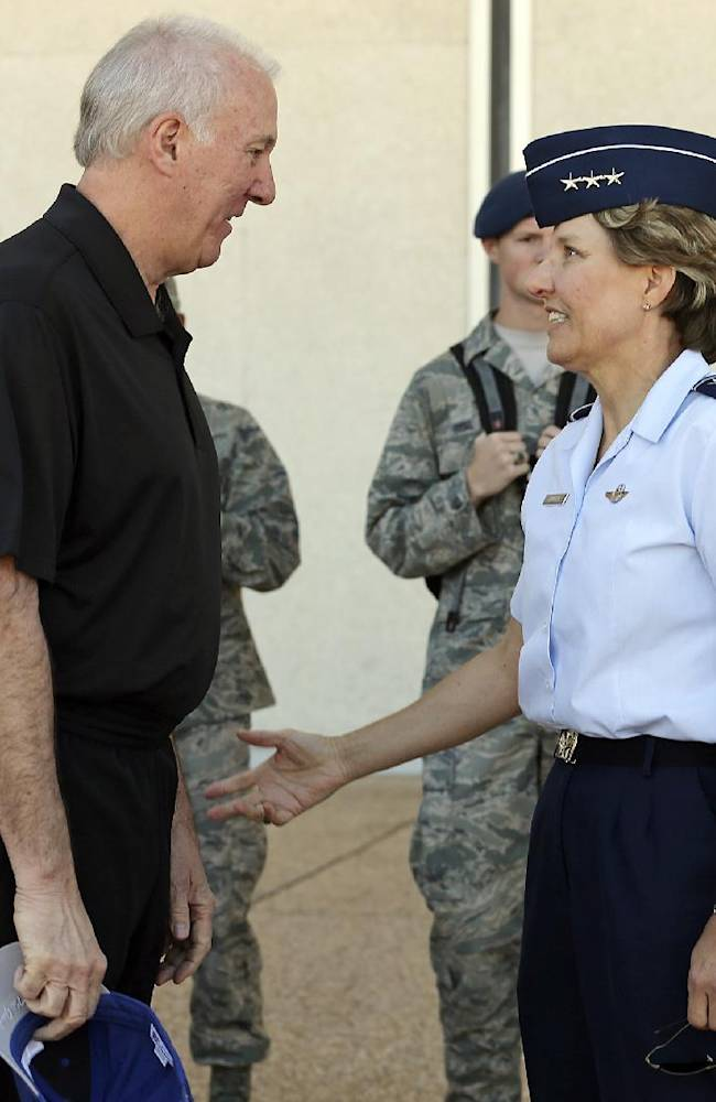 In this Thursday, Oct. 3, 2013, photo, San Antonio Spurs NBA basketball head coach Gregg Popovich, an Air Force Academ alum, meets with U.S. Air Force Academy Superintendent Lt. Gen. Michelle D. Johnson before lunch with cadets at Mitchell Hall in Colorado Springs, Colo. At lunch Thursday, the Spurs watched cadets parade into the dining hall, with players and coaches snapping pictures and capturing video, before sitting down to dine with them as guests of honor