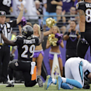 Baltimore Ravens running back Justin Forsett (29) reacts to his touchdown as Carolina Panthers cornerback Antoine Cason (20) lies on the turf during the first half of an NFL football game in Baltimore, Sunday, Sept. 28, 2014. The Associated Press