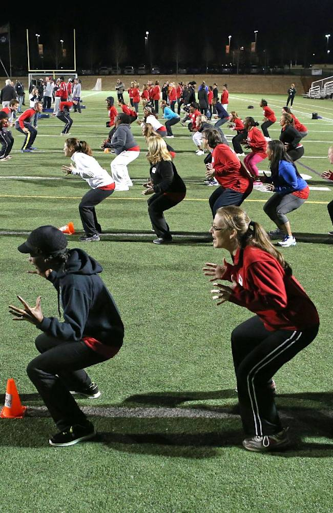 Moms participate in drills during the Atlanta Falcons first ever Mom's Football Safety Clinic at King's Ridge Christian School Tuesday, March 18, 2014, in Alpharetta, Ga. The clinic was designed for moms who have a son or daughter playing youth football or are thinking about playing