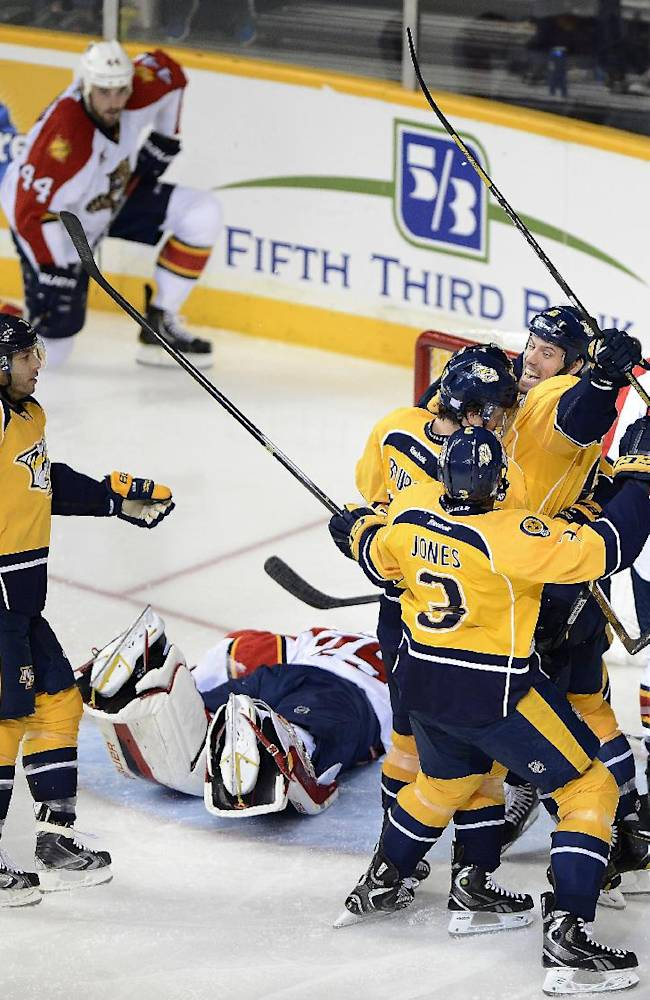 Nashville Predators forward Matt Cullen, left, Seth Jones (3) and Shea Weber, second from right, celebrate after teammate forward Craig Smith scored a goal against the Florida Panthers in the third period of an NHL hockey game on Tuesday, Oct. 15, 2013, in Nashville, Tenn. Nashville Predators won 4-3