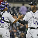 Colorado Rockies relief pitcher LaTroy Hawkins is congratulated by catcher Wilin Rosario after closing out the Rockies' 3-2 victory over the San Diego Padres in a baseball game Tuesday, April 15, 2014, in San Diego The Associated Press