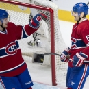 Montreal Canadiens' Max Pacioretty (67) is congratulated by teammate Lars Eller (81) following a shorthanded goal against the Toronto Maple Leafs during the second period of an NHL hockey game Saturday, Nov. 30, 2013 in Montreal The Associated Press