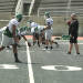In this photo taken on Aug. 15, 2014, Eastern Michigan players line up for a play during NCAA college football practice at Rynearson Stadium in Ypsilanti, Mich.. The school has replaced the stadium's green artificial turf with gray FieldTurf