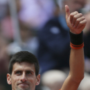 Serbia's Novak Djokovic thumbs up after defeating Thanasi Kokkinakis of Australia during their third round match of the French Open tennis tournament at the Roland Garros stadium, Saturday, May 30, 2015 in Paris. Djokovic won 6-4, 6-4, 6-4. (AP Photo/David Vincent)