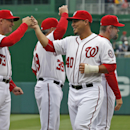 Washington Nationals catcher Wilson Ramos (40) greets bench coach Randy Knorr (53) and others, during introductions before a baseball home opener at Nationals Park Friday, April 4, 2014, in Washington. Ramos injured his hand in the season opener and is on