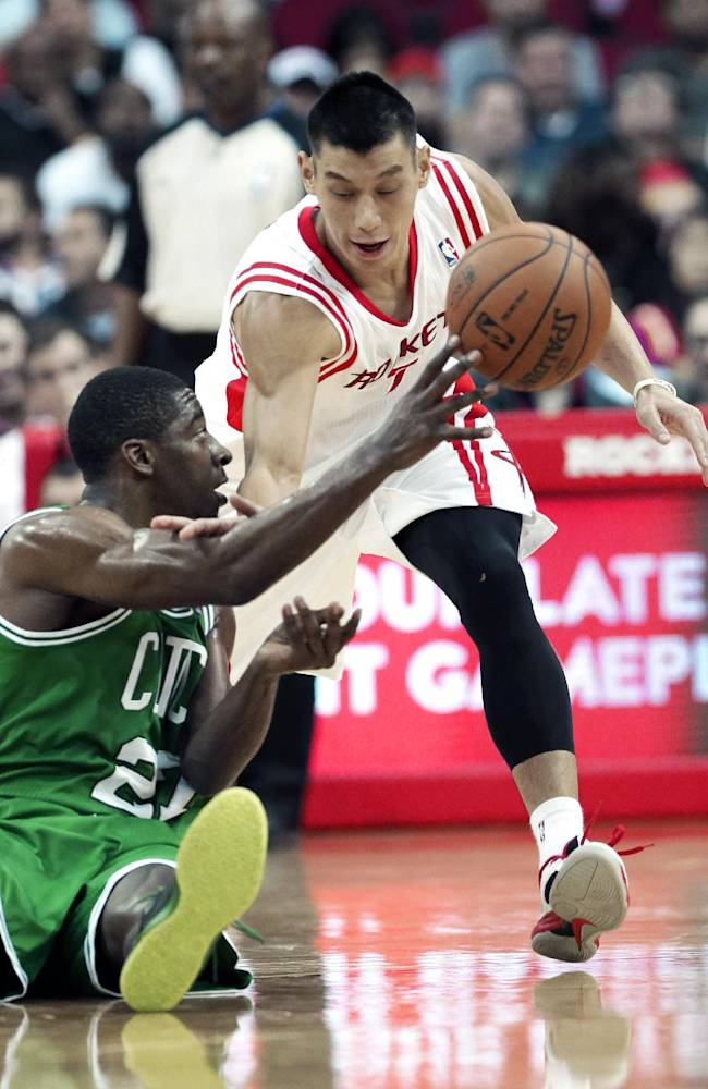 Boston Celtics' Jordan Crawford (27) tries to pass off the ball as Houston Rockets' Jeremy Lin grabs for him in the second half of an NBA basketball game Tuesday, Nov. 19, 2013, in Houston. The Rockets won 109-85