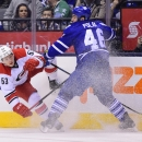 Carolina Hurricanes' Jeff Skinner (53) tangles with Toronto Maple Leafs' Roman Polak (46) during first period of an NHL game in Toronto, Monday, Jan. 19, 2015 The Associated Press